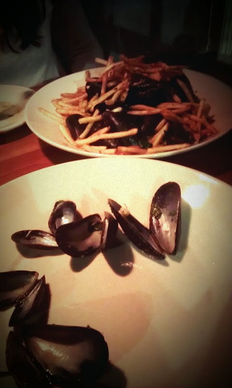 Braised mussels from Sweet Waters. It's an appetizer but I get it as a meal. They serve the mussels with shoe string fries. As you eat the mussels the fries start to fall into the sauce and get soft but not soggy. Its pure sea-comfort-food!