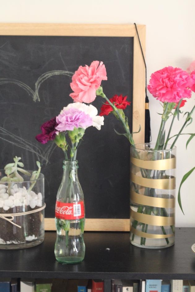 Flowers in coke bottles